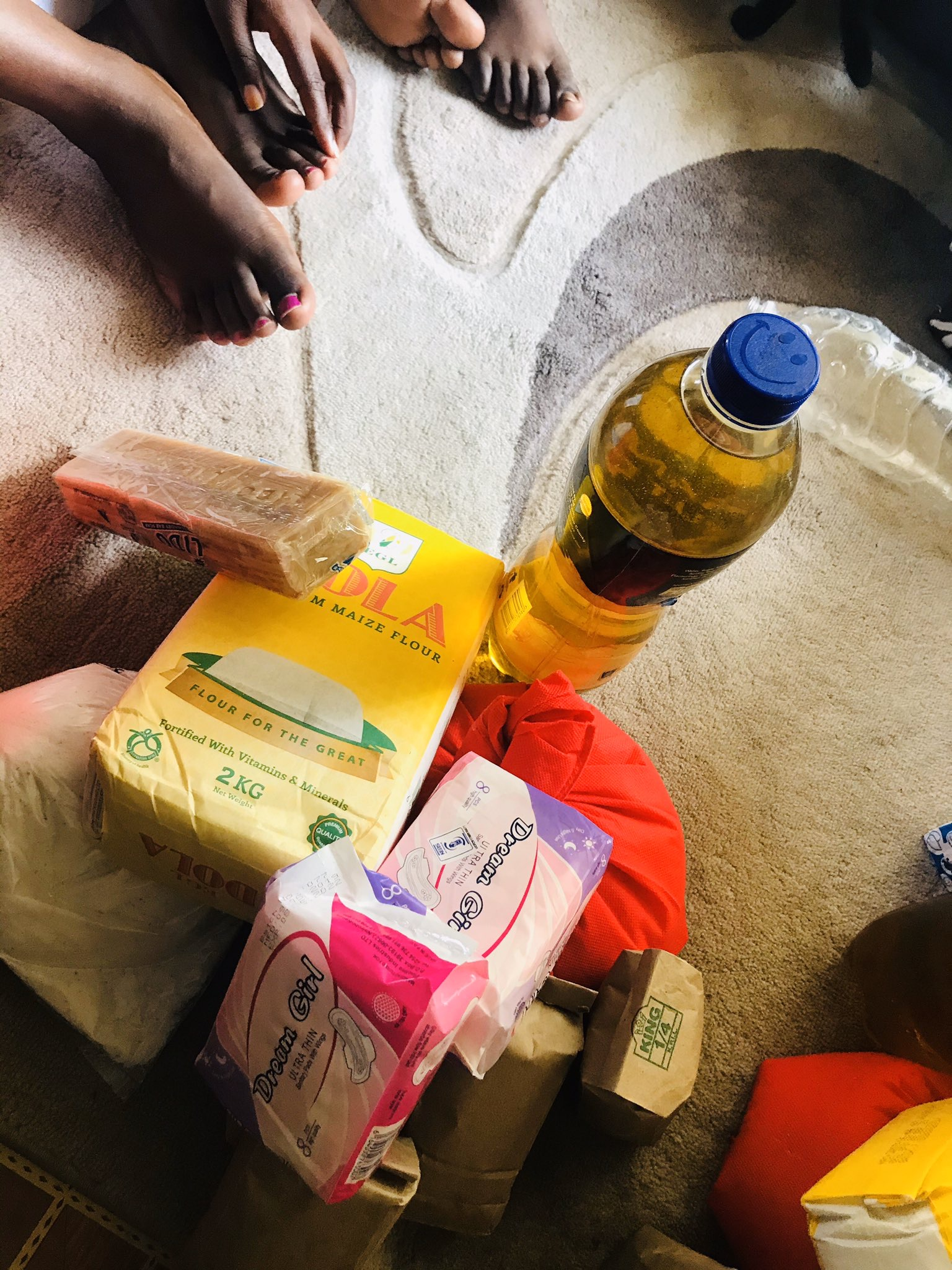 Corn flour, pads, oil, and other items received during the Covid-19 aid drive.